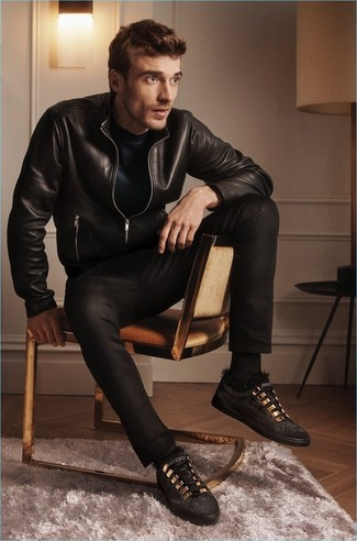 How to wear: black leather bomber jacket, black crew-neck t-shirt, black jeans, black suede low top sneakers