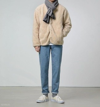 How to Wear a Bomber Jacket For Men: This combination of a bomber jacket and light blue jeans is super easy to do and so comfortable to sport throughout the day as well! On the footwear front, this outfit is completed wonderfully with beige canvas low top sneakers.