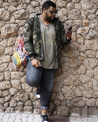 How to Wear an Olive Camouflage Bomber Jacket For Men: An olive camouflage bomber jacket and grey jeans have become must-have wardrobe styles for most gents. If you're wondering how to finish off, introduce multi colored canvas low top sneakers to the equation.