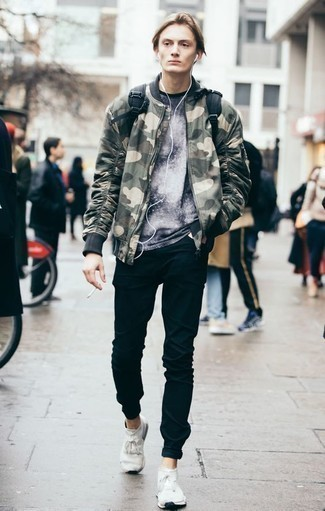 How to Wear an Olive Camouflage Bomber Jacket For Men: An olive camouflage bomber jacket and black jeans are absolute menswear must-haves if you're planning a casual wardrobe that matches up to the highest style standards. White athletic shoes are guaranteed to bring a hint of stylish effortlessness to this ensemble.