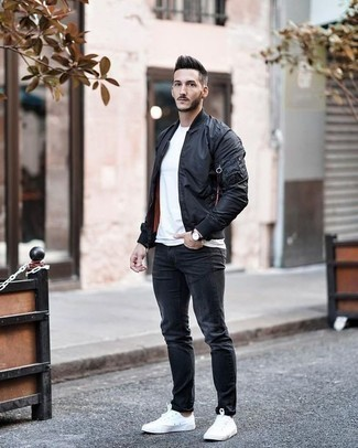 How to Wear a Black Leather Watch In Your 20s For Men: For a never-failing casual option, you can rely on this combo of a black bomber jacket and a black leather watch. If you feel like stepping it up a bit, complete this look with white canvas low top sneakers.