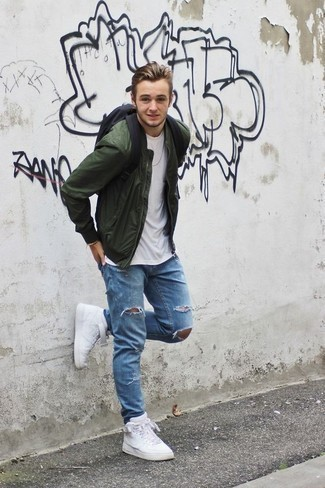 How to Wear a Dark Green Bomber Jacket For Men: A dark green bomber jacket and light blue ripped jeans are awesome menswear items to have in your day-to-day off-duty routine. Now all you need is a pair of white leather high top sneakers to complement this look.