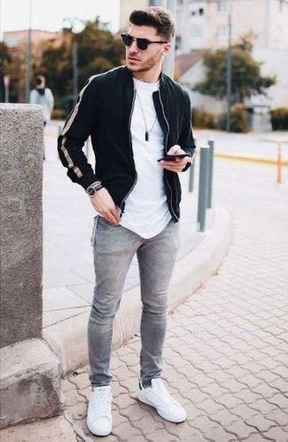 How to Wear Navy Sunglasses In Your 20s For Men: For comfort dressing with an urban twist, choose a black bomber jacket and navy sunglasses. To introduce a little flair to this look, complete this getup with white and green canvas low top sneakers.