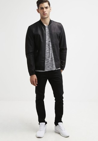 How To Wear a Black Leather Bomber Jacket With Black Jeans For Men: Wear a black leather bomber jacket with black jeans and you'll be ready for wherever the day takes you. Rounding off with a pair of white athletic shoes is a simple way to bring a carefree vibe to your look.
