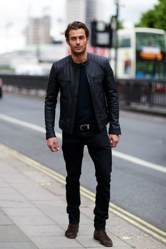 How to Wear Black Jeans In Fall For Men: A black leather bomber jacket and black jeans are both versatile menswear staples that will integrate perfectly within your current collection. Bring an elegant twist to an otherwise everyday look by finishing with a pair of dark brown suede chelsea boots. It's a viable option when it comes to planning a well-coordinated ensemble for unpredictable fall weather.