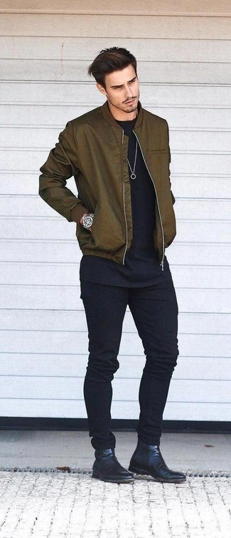 How To Wear an Olive Bomber Jacket With Black Jeans For Men: An olive bomber jacket and black jeans are a great combination that will carry you throughout the day. Make your outfit a bit smarter by finishing off with a pair of black leather chelsea boots.