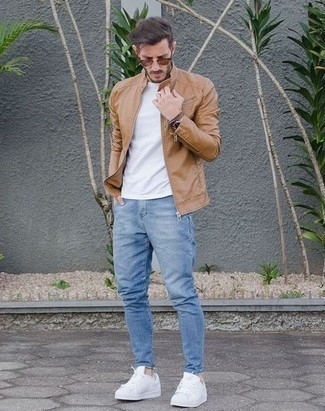 Tan Leather Jacket Outfits For Men: The combination of a tan leather jacket and light blue jeans makes for a solid laid-back look. White canvas low top sneakers work amazingly well with this ensemble.