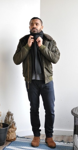 Brown Suede Chelsea Boots Outfits For Men: Choose an olive bomber jacket and navy jeans to feel absolutely confident in yourself and look casual and cool. Channel your inner Idris Elba and introduce a pair of brown suede chelsea boots to the equation.