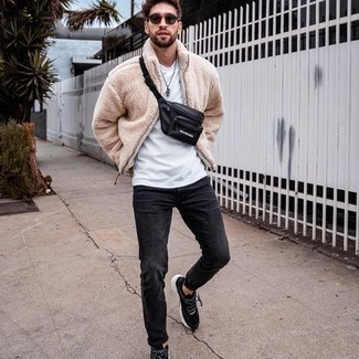 Black Jeans Spring Outfits For Men: This combo of a beige fleece bomber jacket and black jeans is a safe bet for an effortlessly dapper look. For something more on the daring side to round off your look, introduce a pair of black and white athletic shoes to this ensemble. As the weather starts to warm up, it's time to  get rid of those bulky winter layers and opt for something lighter, like this look here.