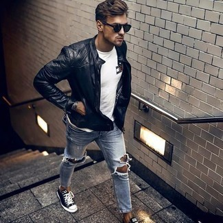 Black Quilted Leather Bomber Jacket Outfits For Men: A black quilted leather bomber jacket and light blue ripped jeans make for the ultimate casual style for any gentleman. Lift up this ensemble with the help of navy and white canvas low top sneakers.