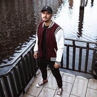 Black Ripped Jeans Outfits For Men: Opt for a burgundy bomber jacket and black ripped jeans for a relaxed twist on day-to-day fashion. For something more on the dressier side to finish this look, enter a pair of burgundy canvas low top sneakers into the equation.