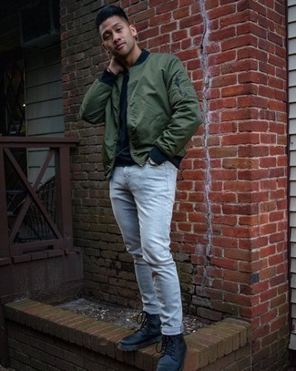 Olive Bomber Jacket Outfits For Men: Go for an olive bomber jacket and grey jeans to pull together a truly dapper and current casual outfit. Feeling adventerous? Dress up this getup by slipping into black leather casual boots.