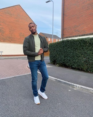 Blue Jeans Outfits For Men: For a casual outfit, consider wearing a dark green bomber jacket and blue jeans — these two items play pretty good together. Serve a little outfit-mixing magic by finishing off with white athletic shoes.