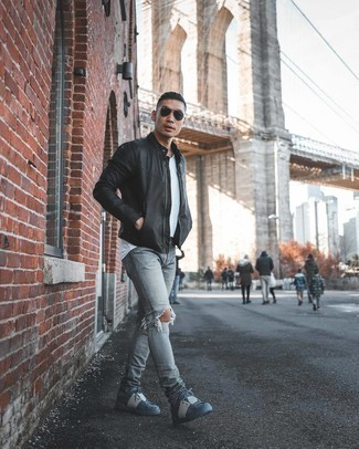 Low Top Sneakers Outfits For Men: Team a black leather bomber jacket with grey ripped jeans if you're after an outfit option for when you want to look casually dapper. Give a dose of class to your ensemble by finishing with a pair of low top sneakers.