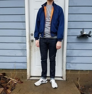 Bomber Jacket Outfits For Men: If the setting allows casual styling, rock a bomber jacket with navy jeans. You can take a more laid-back approach with shoes and add white and black athletic shoes to the mix.