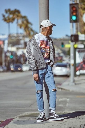 White Print Crew-neck T-shirt Outfits For Men: A white print crew-neck t-shirt and light blue ripped jeans make for the perfect base for a casually stylish look. Look at how nice this getup goes with black and white canvas high top sneakers.