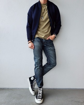 Black and White Canvas High Top Sneakers Outfits For Men: You'll be amazed at how easy it is for any gent to put together this casual ensemble. Just a navy bomber jacket worn with navy jeans. Let your outfit coordination skills truly shine by finishing off your ensemble with black and white canvas high top sneakers.