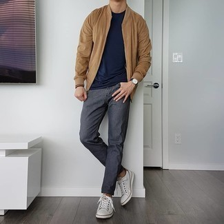 Charcoal Jeans Outfits For Men: Choose a tan bomber jacket and charcoal jeans to put together an everyday ensemble that's full of charisma and character. Introduce white leather low top sneakers to the mix et voila, the outfit is complete.
