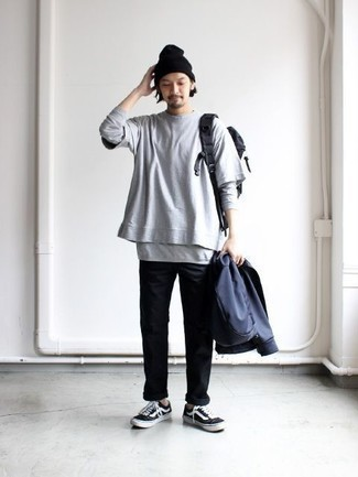 How to Wear a Black Canvas Backpack For Men: Busy off-duty days require a simple yet neat and relaxed outfit, such as a navy bomber jacket and a black canvas backpack. Complement your ensemble with a pair of black and white canvas low top sneakers to jazz things up.