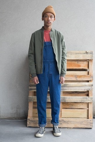 Blue Denim Overalls Outfits For Men: For a look that's super straightforward but can be styled in plenty of different ways, wear an olive bomber jacket and blue denim overalls. Our favorite of a ton of ways to complete this outfit is a pair of navy and white canvas high top sneakers.