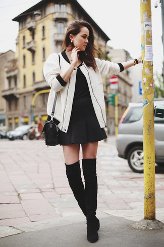 Wear a white bomber jacket and a black skater skirt to be both cool and relaxed. A pair of black suede thigh high boots will add more polish to your overall look. This combo is super functional and will help you out in unpredictable spring weather.