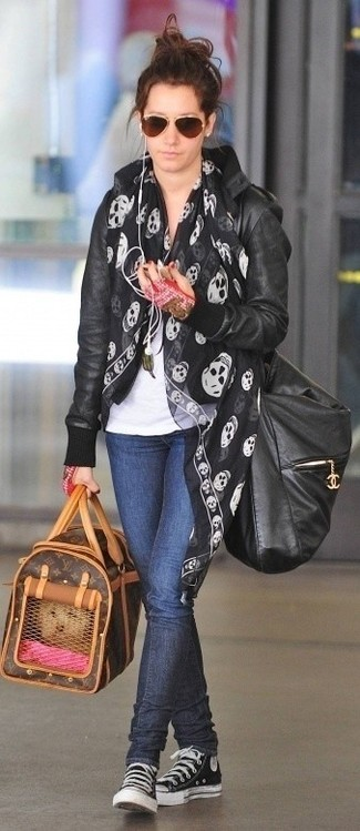 Sandra Bullock wearing Black Leather Bomber Jacket, White Crew-neck T-shirt, Navy Skinny Jeans, Black and White Canvas High Top Sneakers
