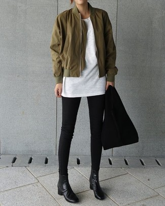 How to wear: olive bomber jacket, white crew-neck t-shirt, black skinny jeans, black leather chelsea boots