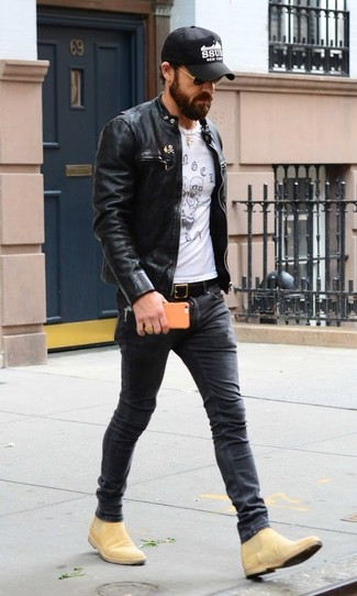 How to wear: black leather bomber jacket, white and black print crew-neck t-shirt, charcoal skinny jeans, tan suede chelsea boots