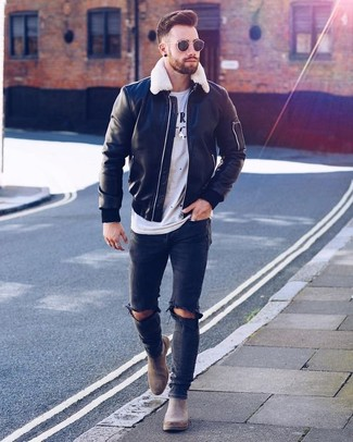How to wear: black leather bomber jacket, white and black print crew-neck t-shirt, black ripped skinny jeans, grey suede chelsea boots