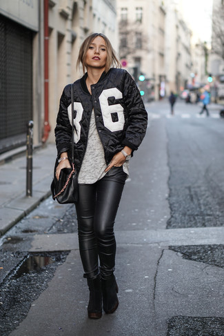 How to Wear a Black and White Bomber Jacket For Women: The pairing of a black and white bomber jacket and black leather skinny jeans makes this a solid casual look. For something more on the dressier side to finish off this look, throw a pair of black chunky suede ankle boots into the mix.