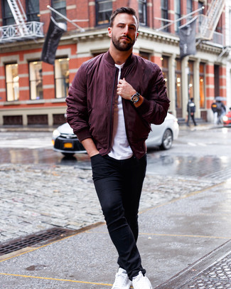 How to wear: burgundy bomber jacket, white crew-neck t-shirt, black skinny jeans, white leather low top sneakers