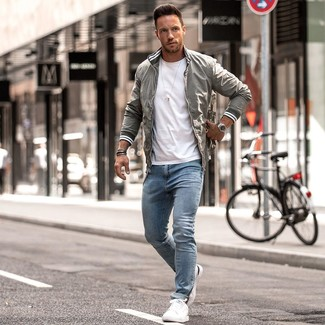 How to wear: grey bomber jacket, white crew-neck t-shirt, light blue skinny jeans, white leather low top sneakers