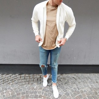 How to wear: white bomber jacket, tan crew-neck t-shirt, light blue ripped skinny jeans, white low top sneakers
