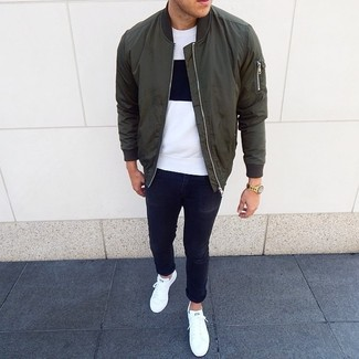 How to wear: olive bomber jacket, white and black crew-neck t-shirt, black skinny jeans, white low top sneakers