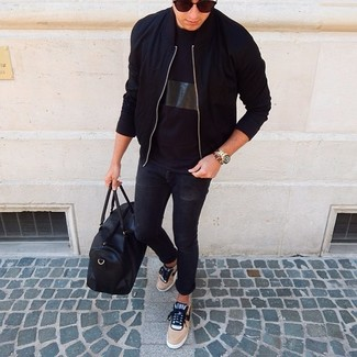 How to wear: black bomber jacket, black crew-neck t-shirt, black skinny jeans, tan low top sneakers