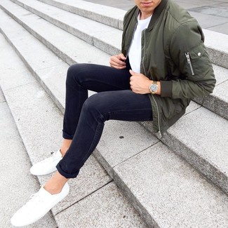 How to wear: olive bomber jacket, white crew-neck t-shirt, black skinny jeans, white low top sneakers
