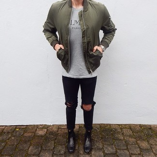 How to wear: olive bomber jacket, grey print crew-neck t-shirt, black ripped skinny jeans, black leather chelsea boots