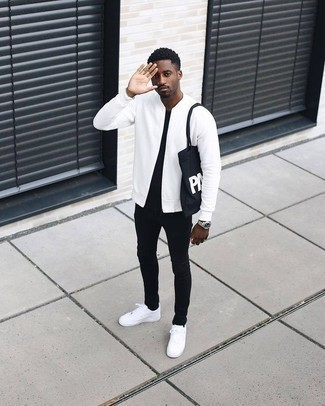 How to Wear a White Bomber Jacket In Your 30s For Men: A white bomber jacket and black skinny jeans are both versatile menswear must-haves that will integrate wonderfully within your casual styling repertoire. A pair of white leather low top sneakers looks perfect here.