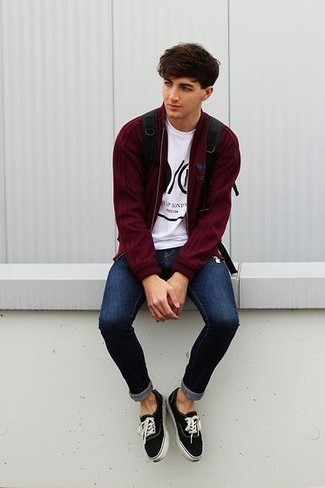 Navy Ripped Skinny Jeans Outfits For Men: For a laid-back outfit, wear a burgundy bomber jacket and navy ripped skinny jeans — these two items play really well together. Want to go all out with shoes? Introduce a pair of black and white canvas low top sneakers to the equation.