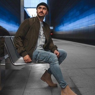 Olive Bomber Jacket Outfits For Men: An olive bomber jacket and light blue skinny jeans are the kind of a never-failing casual look that you need when you have no extra time to dress up. And if you want to immediately step up your ensemble with one piece, why not complement your look with tan suede chelsea boots?