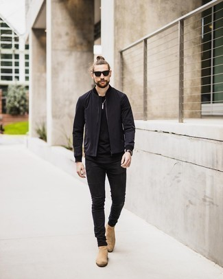 Tan Suede Chelsea Boots with Black Jeans Outfits For Men: You'll be amazed at how super easy it is for any guy to throw together this laid-back getup. Just a black bomber jacket worn with black jeans. Put a smarter spin on this outfit by slipping into a pair of tan suede chelsea boots.