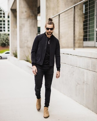 Black Bomber Jacket with Black Skinny Jeans Outfits For Men: This combination of a black bomber jacket and black skinny jeans is beyond versatile and creates instant appeal. Let your outfit coordination savvy truly shine by finishing your look with tan suede chelsea boots.