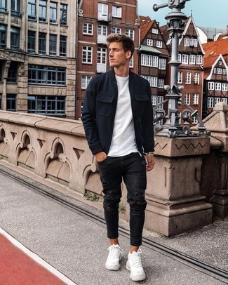White Print Crew-neck T-shirt Outfits For Men: A white print crew-neck t-shirt and black ripped skinny jeans are totally worth being on your list of indispensable casual styles. A cool pair of white athletic shoes pulls this ensemble together.