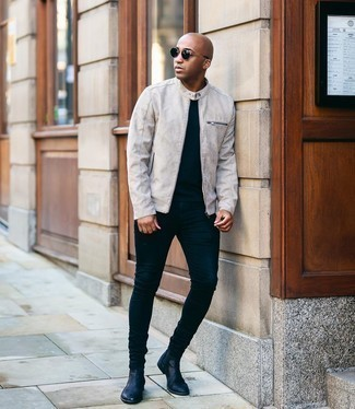 Men's Outfits 2020: This laid-back pairing of a grey suede bomber jacket and navy skinny jeans is extremely easy to put together without a second thought, helping you look on-trend and prepared for anything without spending too much time digging through your wardrobe. Black leather chelsea boots will take your ensemble in a dressier direction.