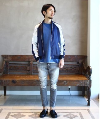 Black Leather Loafers Outfits For Men: Go for a straightforward but casually dapper option in a navy and white bomber jacket and grey ripped skinny jeans. You can take a more polished approach with shoes and complement this look with a pair of black leather loafers.