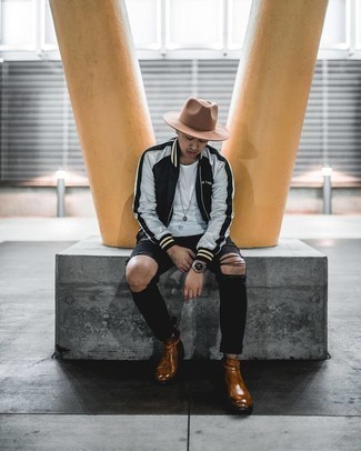 Black Ripped Skinny Jeans Outfits For Men: A black bomber jacket and black ripped skinny jeans are great menswear essentials that will integrate perfectly within your off-duty arsenal. Why not take a classic approach with footwear and introduce brown leather chelsea boots to your getup?