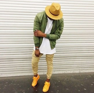 How to wear: olive bomber jacket, white crew-neck t-shirt, tan sweatpants, yellow low top sneakers