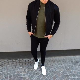 How to Wear a Black Bomber Jacket For Men: Consider wearing a black bomber jacket and black sweatpants for a laid-back kind of class. Introduce white leather low top sneakers to the mix and ta-da: this ensemble is complete.