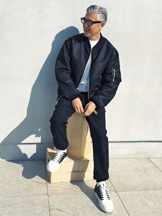 How to Wear Navy Sweatpants For Men: Choose a navy bomber jacket and navy sweatpants for a casual level of dress. If you're on the fence about how to finish, a pair of black and white canvas low top sneakers is a never-failing option.