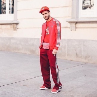 Red Bomber Jacket Outfits For Men: Look dapper yet functional by opting for a red bomber jacket and red sweatpants. A pair of red canvas low top sneakers is a nice option to finish off this ensemble.